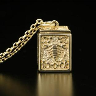 GOLD CLOTH BOX PENDANT SCORPIO