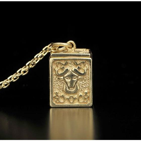 GOLD CLOTH BOX PENDANT TAURUS